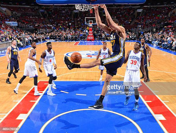 Rudy Gobert of the Utah Jazz dunks the ball against the Philadelphia 76ers at Wells Fargo Center on March 6 2015 in Philadelphia Pennsylvania NOTE TO...