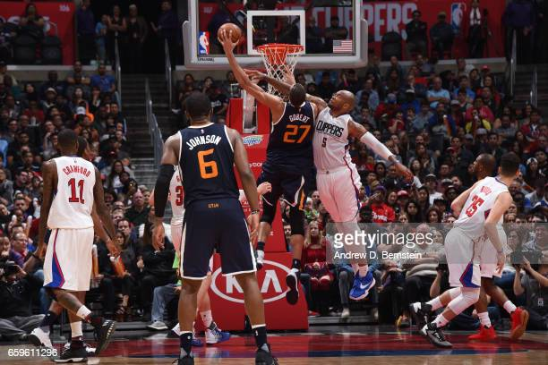 Rudy Gobert of the Utah Jazz goes up for a dunk against Marreese Speights of the LA Clippers during a game on March 25 2017 at STAPLES Center in Los...