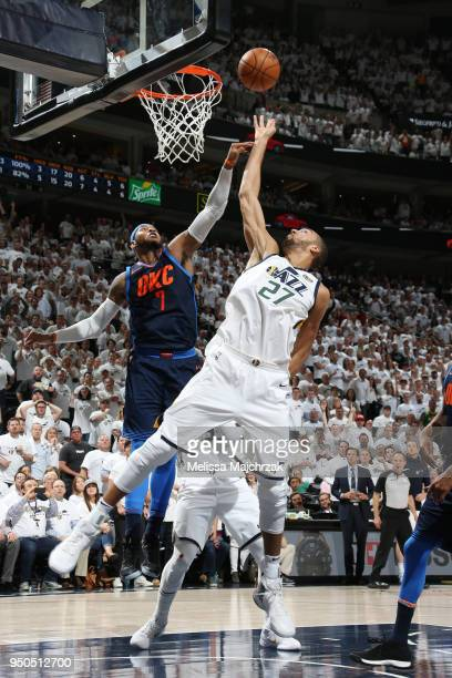Rudy Gobert of the Utah Jazz goes up for a rebound against the Oklahoma City Thunder in Game Four of Round One of the 2018 NBA Playoffs on April 23...