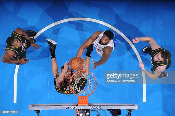 Rudy Gobert of the Utah Jazz grabs a rebound against the Los Angeles Clippers on December 29 2014 at STAPLES Center in Los Angeles California NOTE TO...