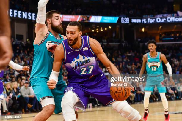 Rudy Gobert of the Utah Jazz handles the ball against Jonas Valanciunas of the Memphis Grizzlies during the first half at FedExForum on November 29...