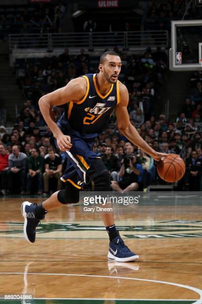 Rudy Gobert of the Utah Jazz handles the ball against the Milwaukee Bucks on December 9 2017 at the BMO Harris Bradley Center in Milwaukee Wisconsin...