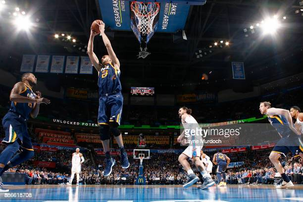 Rudy Gobert of the Utah Jazz handles the ball against the Oklahoma City Thunder on December 5 2017 at Chesapeake Energy Arena in Oklahoma City...