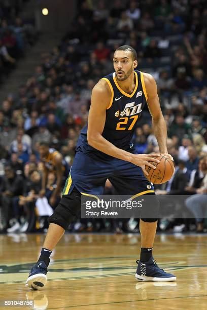 Rudy Gobert of the Utah Jazz handles the ball during a game against the Milwaukee Bucks at the Bradley Center on December 9 2017 in Milwaukee...