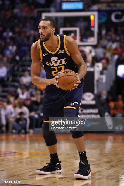 Rudy Gobert of the Utah Jazz handles the ball during the second half of the NBA game against the Phoenix Suns at Talking Stick Resort Arena on...