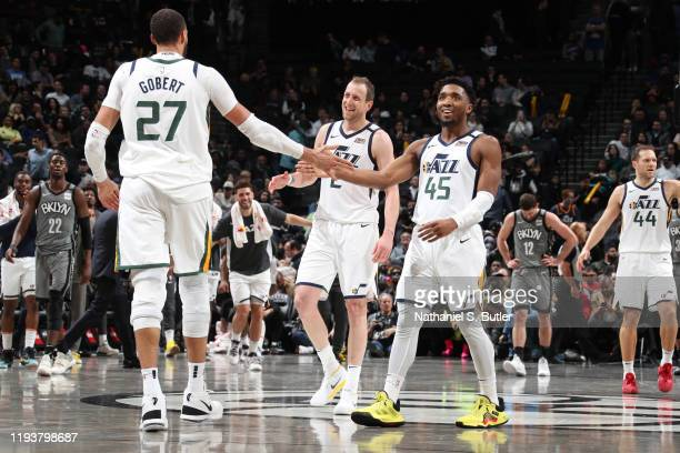 Rudy Gobert of the Utah Jazz high-fives Joe Ingles of the Utah Jazz and Donovan Mitchell of the Utah Jazz during the game against the Brooklyn Nets...