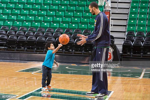 Rudy Gobert of the Utah Jazz holds a basketball clinic with select boys and girls from the Junior Jazz at vivintSmartHome Arena on January 26 2016 in...