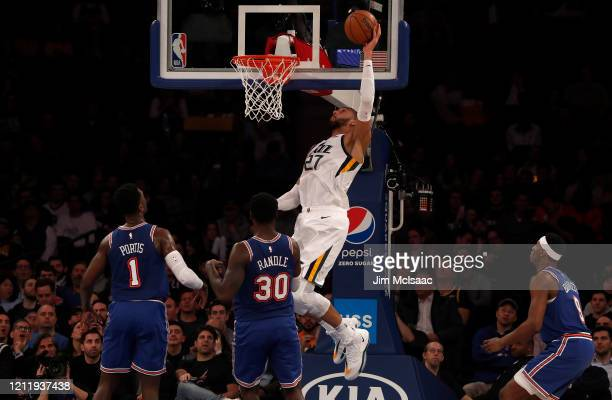 Rudy Gobert of the Utah Jazz in action against Julius Randle and Bobby Portis of the New York Knicks at Madison Square Garden on March 04 2020 in New...