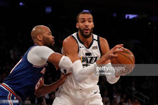 Rudy Gobert of the Utah Jazz in action against Taj Gibson of the New York Knicks at Madison Square Garden on March 04 2020 in New York City The Jazz...