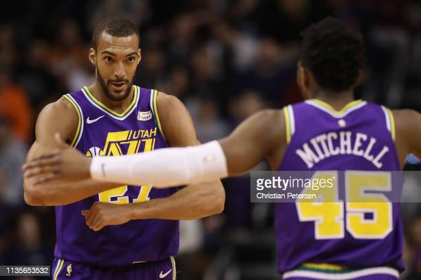 Rudy Gobert of the Utah Jazz is congratulated by Donovan Mitchell after scoring against the Phoenix Suns during the first half of the NBA game at...