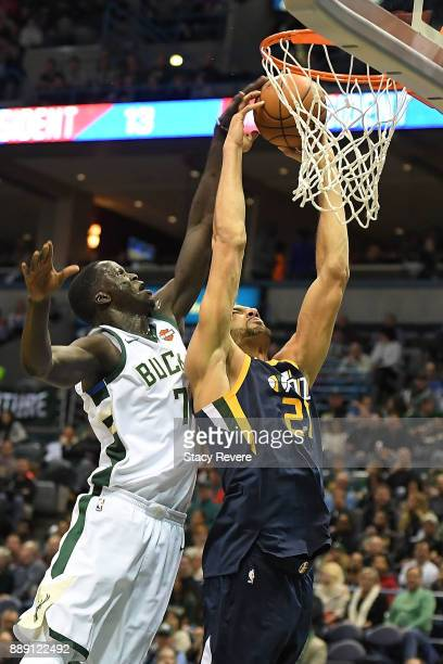 Rudy Gobert of the Utah Jazz is fouled by Thon Maker of the Milwaukee Bucks during the first half of a game at the Bradley Center on December 9 2017...