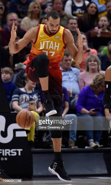 Rudy Gobert of the Utah Jazz lands after a reverse dunk in the second half of a NBA game against the San Antonio Spurs at Vivint Smart Home Arena on...