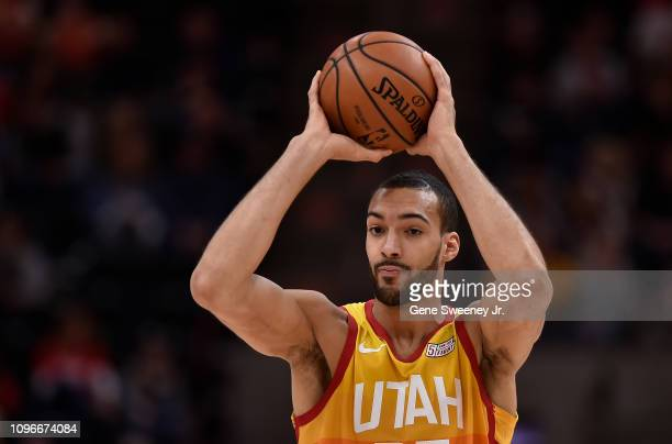 Rudy Gobert of the Utah Jazz looks to pass the ball in the first half of a NBA game against the San Antonio Spurs at Vivint Smart Home Arena on...