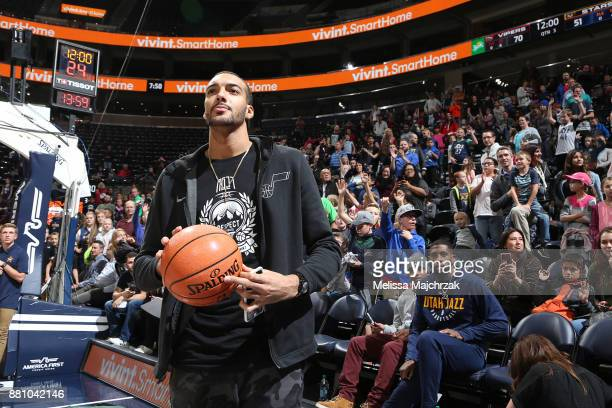 Rudy Gobert of the Utah Jazz looks to throw out a ball to the crowd during halftime at the Salt Lake City Stars game against the Rio Grande Valley...