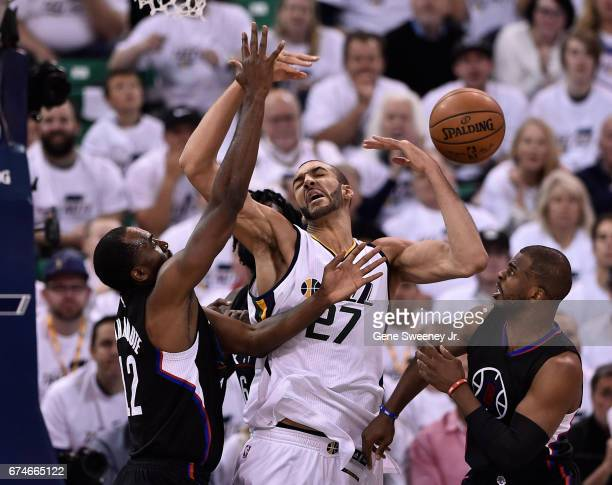 Rudy Gobert of the Utah Jazz loses the ball in the second half of their 9893 loss while being defended by Luc Mbah a Moute and Chris Paul of the Los...