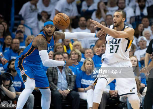 Rudy Gobert of the Utah Jazz passes the ball as Carmelo Anthony of the Oklahoma City Thunder applies pressure during the second half of game 5 of the...