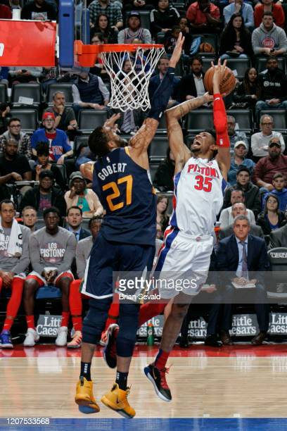 Rudy Gobert of the Utah Jazz plays defense against Christian Wood of the Detroit Pistons on March 7 2020 at Little Caesars Arena in Detroit Michigan...