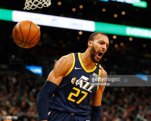 Rudy Gobert of the Utah Jazz reacts after dunking during the third quarter of the game against the Boston Celtics at TD Garden on March 06 2020 in...