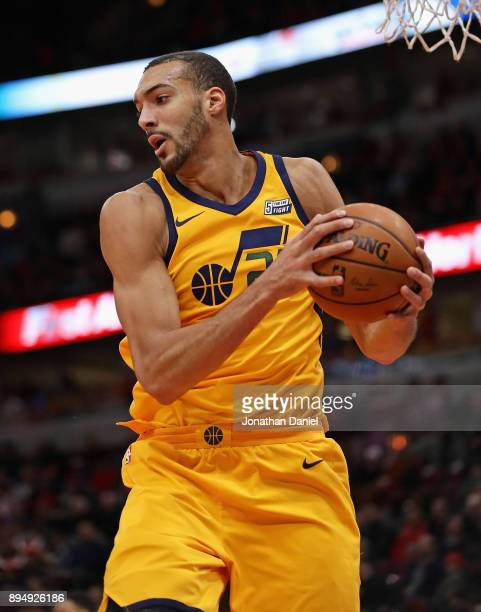 Rudy Gobert of the Utah Jazz rebounds against the Chicago Bulls at the United Center on December 13 2017 in Chicago Illinois The Bulls defeated the...