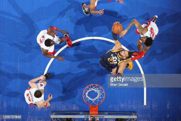 Rudy Gobert of the Utah Jazz rebounds the ball during the game against the the Detroit Pistons on March 7 2020 at Little Caesars Arena in Detroit...