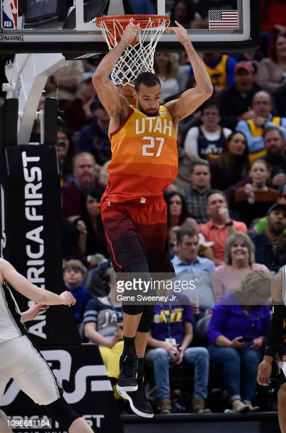 Rudy Gobert of the Utah Jazz scores on a reverse dunk in the second half of a NBA game against the San Antonio Spurs at Vivint Smart Home Arena on...