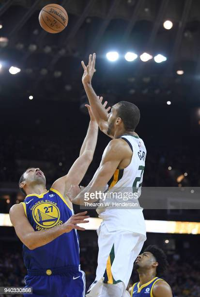 Rudy Gobert of the Utah Jazz shoots over Zaza Pachulia of the Golden State Warriors during an NBA basketball game at ORACLE Arena on March 25 2018 in...