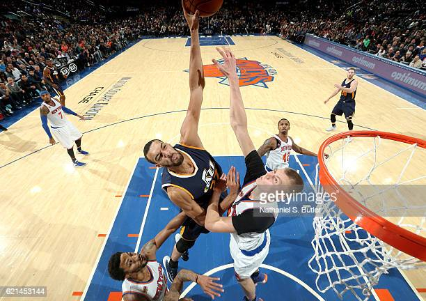 Rudy Gobert of the Utah Jazz shoots the ball against Kristaps Porzingis of the New York Knicks during the game on November 6 2016 at Madison Square...