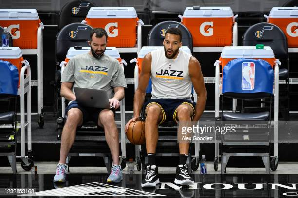 Rudy Gobert of the Utah Jazz sits with coach Alex Jensen before a game against the Portland Trail Blazers at Vivint Smart Home Arena on May 12, 2021...