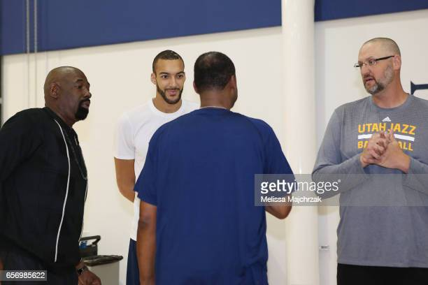 Rudy Gobert of the Utah Jazz speaks to Antoine Carr and Greg Ostertag during a press interview about the 1997 Reunited Western Conference Champs at...