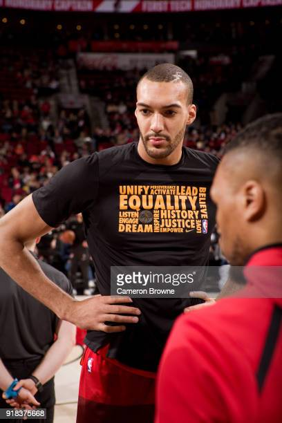 Rudy Gobert of the Utah Jazz speaks to Damian Lillard of the Portland Trail Blazersbefore the game between the two teams on February 11 2018 at the...
