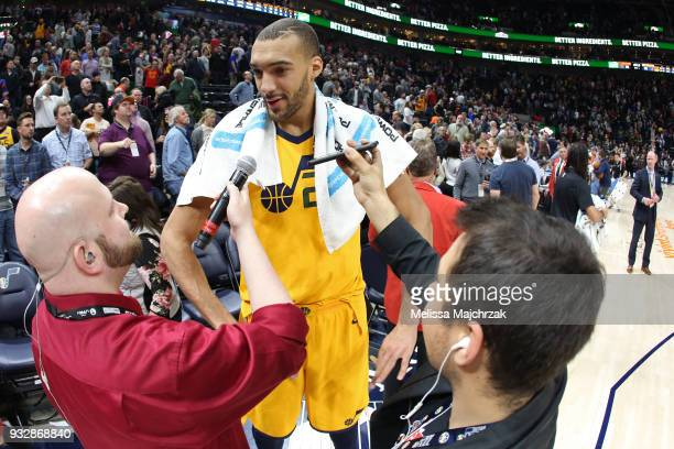 Rudy Gobert of the Utah Jazz talks to the media on the court after the game against the Phoenix Suns on March 15 2018 at vivintSmartHome Arena in...