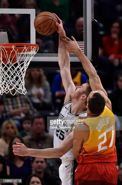 Rudy Gobert of the Utah Jazz tries to block the shot by Jakob Poeltl of the San Antonio Spurs in the first half of a NBA game at Vivint Smart Home...