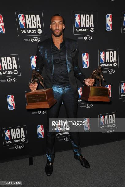 Rudy Gobert winner of the Kia NBA Defensive Player of the Year and member of the NBA AllDefensive Team poses in the press room during the 2019 NBA...
