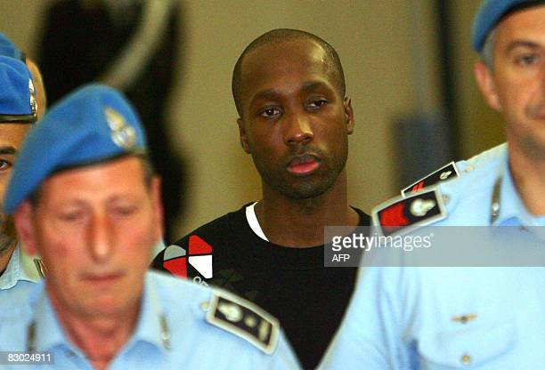Rudy Guede from the Ivory Coast one of the three suspects in the murder of British student Meredith Kercher leaves a court hearing in Perugia on...