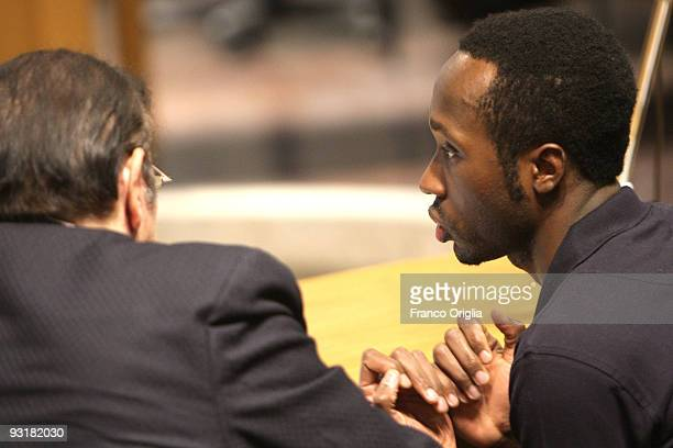 Rudy Guede who was born in the Ivory Coast chats with his lawyer's assistant in the Perugia courthouse during the sitting of his appeal against the...