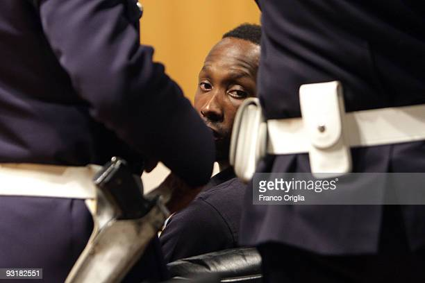 Rudy Guede who was born in the Ivory Coast sits in the Perugia courthouse for the sitting of his appeal against the sentence he received in the...