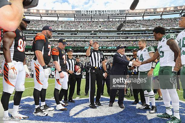 Rudy Guliani shakes hands with Brandon Marshall when he serves as Honorary Captain at the Coin Toss before the New York Jets versus Cincinnati...