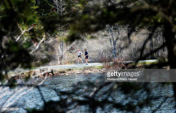 Rudy Kelley of Bernard runs along the carriage trails in Acadia Nation Park with Steve Whalen of Bernard Saturday May 13 2017