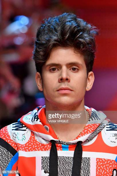 Rudy Mancuso walks the runway at the Dolce Gabbana show during Milan Men's Fashion Week Spring/Summer 2018 on June 17 2017 in Milan Italy