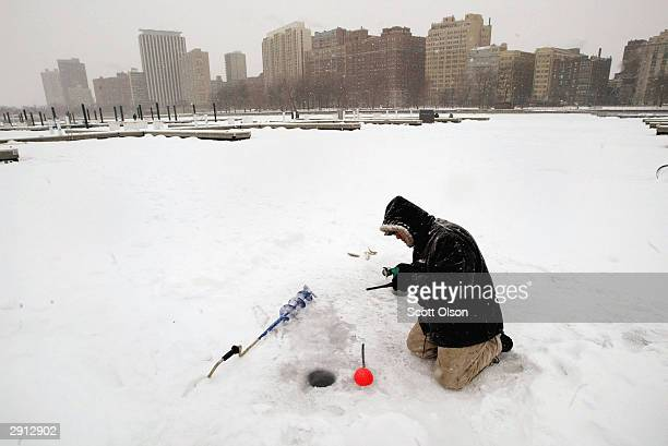 Rudy Manzanunez braves bitter temperatures while ice fishing in Belmont Harbor on Lake Michigan January 29 2004 near downtown Chicago Illinois...