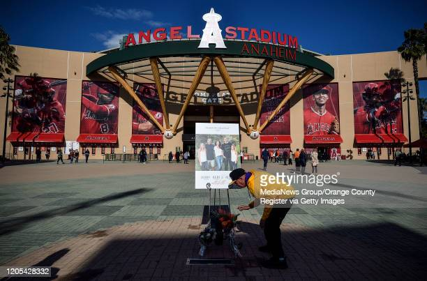 Rudy Ramos sets flowers on the mound outside Angel Stadium before a memorial service for the Altobelli family in Anaheim CA on Monday Feb 10 2020...