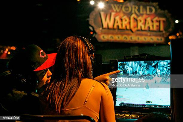 Rudy Ruan, LT, and Olivia Ortiz, both from Arizona exchanging ideas while playing World of Warcraft video game at BlizzCon at the Anaheim Convention...