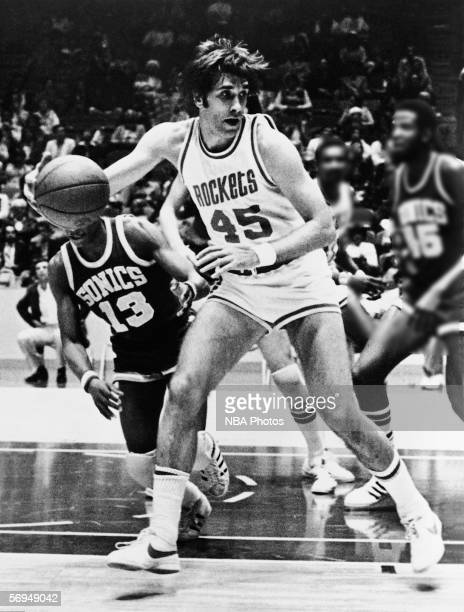 Rudy Tomjanovich of the Houston Rockets backs into the paint against the Seattle Sonics during an NBA game at the Summit circa 1971 in Houston Texas...