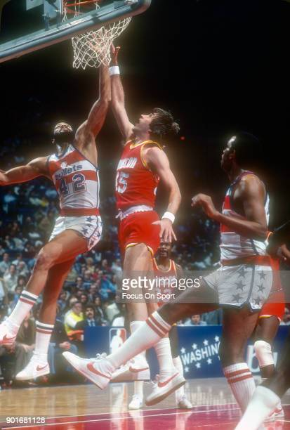 Rudy Tomjanovich of the Houston Rockets battles for a rebound with Greg Ballard of the Washington Bullets during an NBA basketball game circa 1979 at...