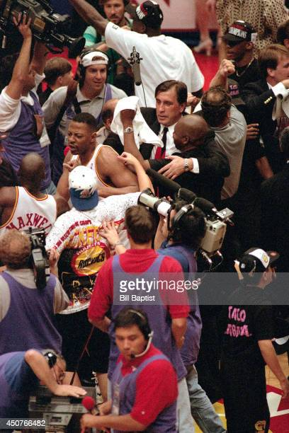 Rudy Tomjanovich of the Houston Rockets celebrates after beating the New York Knicks in Game Seven of the NBA Finals on June 22 1994 at The Summit in...