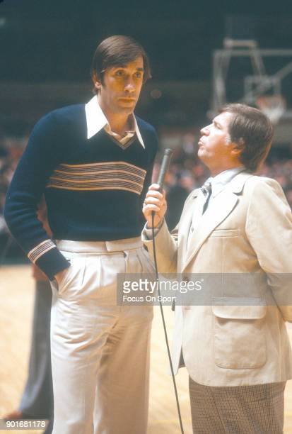 Rudy Tomjanovich of the Houston Rockets gets interviewed prior to the start of an NBA basketball game against the New York Knicks circa 1979 at...