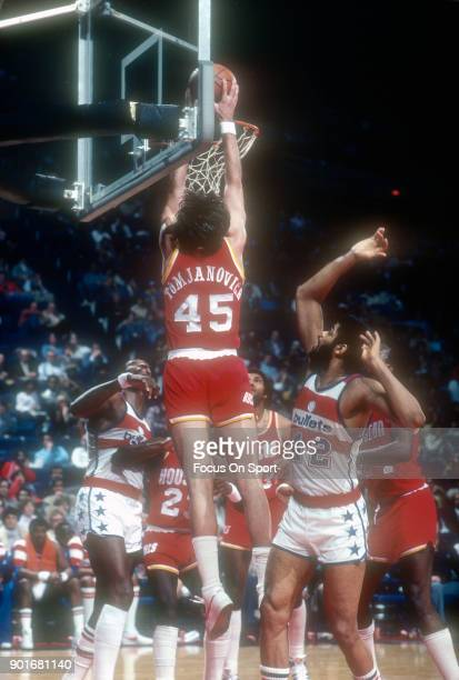 Rudy Tomjanovich of the Houston Rockets goes up for a slam dunk against the Washington Bullets during an NBA basketball game circa 1979 at the...