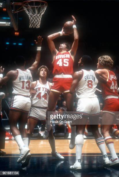 Rudy Tomjanovich of the Houston Rockets goes up to shoot against the New York Knicks during an NBA basketball game circa 1977 at Madison Square...