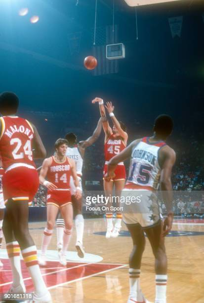 Rudy Tomjanovich of the Houston Rockets shoots over ElvinHayes of the Washington Bullets during an NBA basketball game circa 1979 at the Capital...