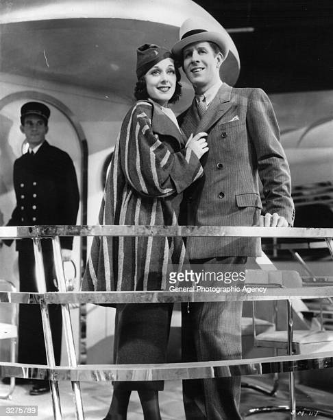 Rudy Vallee and Ann Dvorak are in an affectionate mood in a scene from 'Sweet Music' a musical romance between an orchestra leader and a singer...